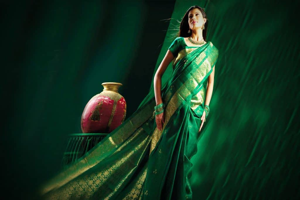 bottle green color saree with golden border