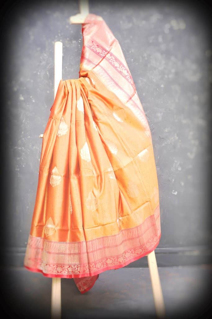 peach color saree with a tune of gold